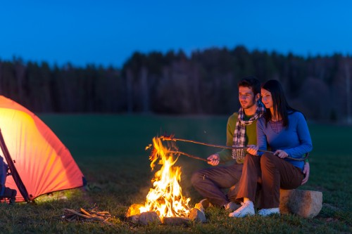 bigstock-Camping-night-couple-cook-by-c-32325227