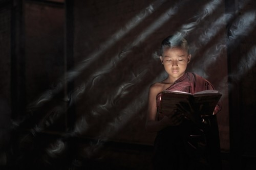 Novice monk with incense smoke (Neil Herbert)